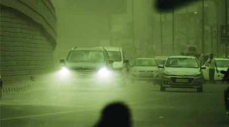 Dust storm, rain cool city, pollution rises on smog cover