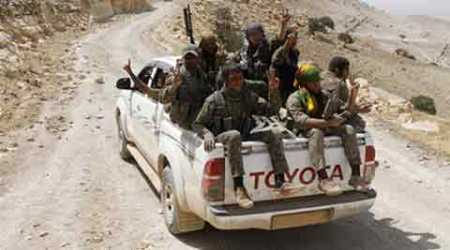 Syria crisis: Rebels seize army base, another defeat for Basharal-Assad