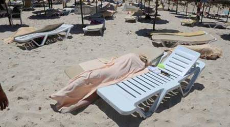 Bodies are covered on a Tunisian beach, in Sousse, Friday June 26, 2015. (Jawhara FM via AP)