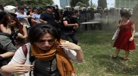 Turkey, Turkey news, Turkey protest, Turkey red dress, red dress lady tear gassed, Police Plants trees inturkey, Turkey police, eyrope news, world news, international news,