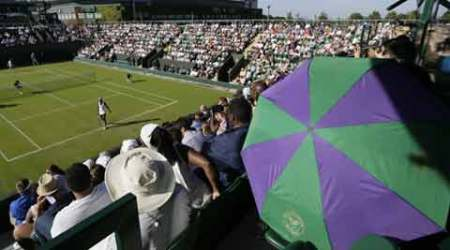 Umbrellas up at Wimbledon - to keep the sun off