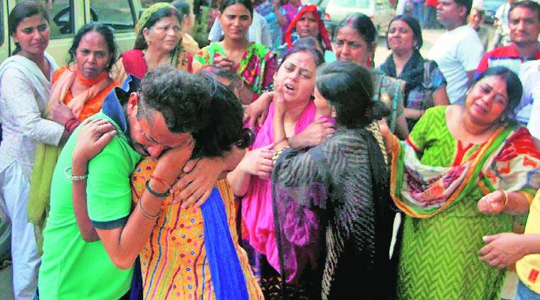 Family members mourn the death of Manoj Sharma at his residence in Allahabad on Friday. (Source: PTI photo)