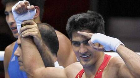 Vijender Singh turns pro, hangs up gloves on Olympic hopes