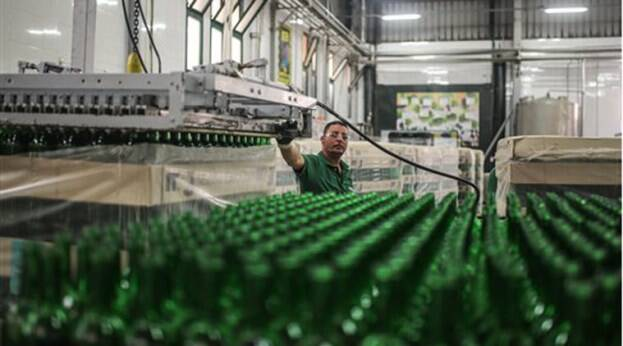 In this Wednesday, May 27, 2015 photo, a worker observes bottles on a production line at the Gianaclis winery, one of Egypt's main wineries, in the Nile Delta, north of Cairo, Egypt. (AP Photo/Mosa'ab Elshamy)