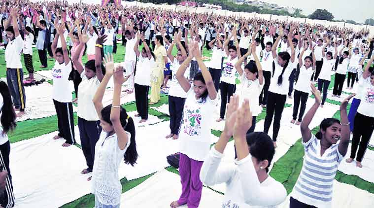Children take part in an event to mark International Yoga Day in Chandigarh on Sunday.