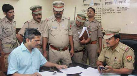 Amitabh Thakur files the complaint at Hazratganj police station, in Lucknow on Saturday. (Source: PTI)