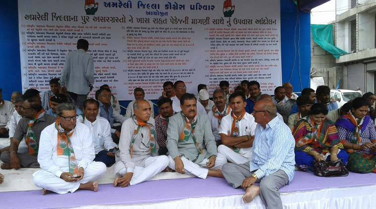 Paresh Dhanani (folded hands) during his hunger strike, in Amreli on Monday. (Source: Express photo by Gopal Kateshiya)