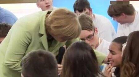 Crying refugee girl, Angela Merkel, Angela Merkel Crying girl, Merkel Crying girl, German chancellor, international news, news