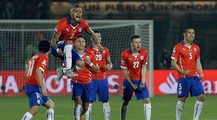 Chile's Arturo Vidal celebrates during a penalty shootout at the final Copa America soccer match against Argentina at the National Stadium in Santiago, Chile, Saturday, July 4, 2015. Chile became Copa America champions for the first time. (Source: AP)