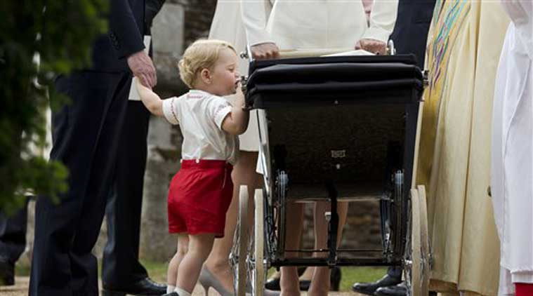 The inquisitive toddler wonders what's in the carriage