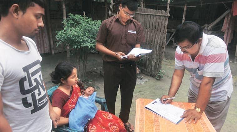 Officials from India and Bangladesh at Prakash Barman's house, seeking information on their newborn, at Shibprasad Mustafi, a Bangladeshi enclave in India. (Source: Express photo by Partha Paul)