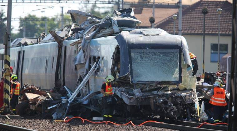 Rescue workers are busy at the scene of a collision between a high-speed train and a truck in the city of Studenka, eastern Czech Republic, Wednesday, July 22, 2015. Two people died in the collision and more than a dozen were injured. (AP Photo,CTK/Petr Sznapka) SLOVAKIA OUT