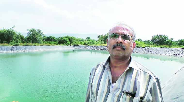 Rajendra Patil at his farm pond.