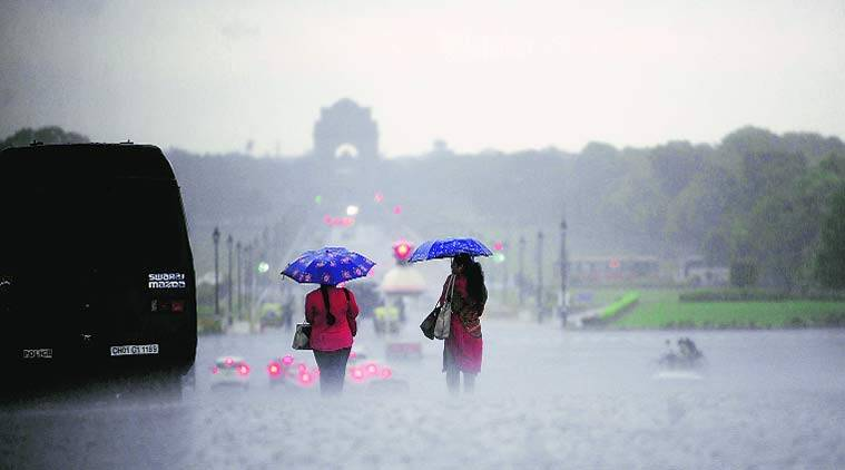At Rajpath on Monday. The downpour resulted in traffic jams. (Source: Express photo by Anil Sharma/Tashi Tobgyal)