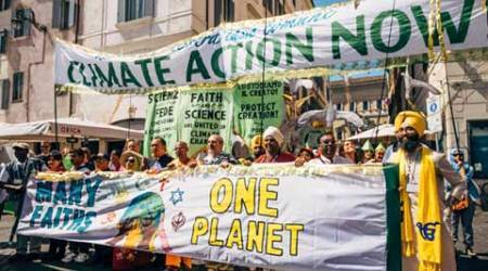 Sikh youth sings Guru Nanak's enviroment message at multi-faith dialogue on climate change