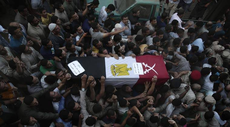 FILE - In this Thursday, July 2, 2015 file photo, Egyptians carry the coffin of 1st Lt. Mohammed Adel Abdel Azeem, killed in Wednesday's attack by Islamic State-affliated militants in the Sinai, during the funeral procession at his home village Tant Al Jazeera in Qalubiyah, north of Cairo, Egypt. After a series of stunning militant attacks, including the last week's major militant assault in the Sinai Peninsula, the government is pushing through a new controversial anti-terrorism draft bill. (AP Photo/Hassan Ammar, File)