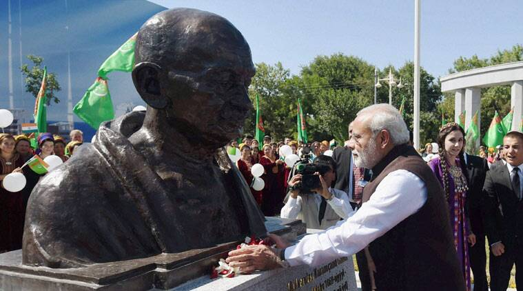 Ashgabat: Prime Minister Narendra Modi unveiling a bust of Mahatma Gandhi at Bagtyarlyk Sports Complex at Ashgabat in Turkmenistan on Saturday. PTI Photo by Manvender Vashist