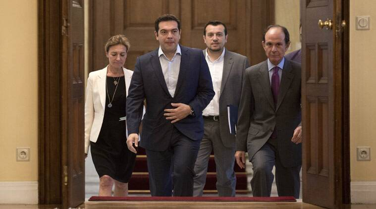 "Greek Prime Minister Alexis Tsipras, second from right, arrives for a Greek political leaders meeting in Athens, on Monday, July 6, 2015. Finance Minister Yanis Varoufakis has resigned following Sunday's referendum in which the majority of voters said ""no"" to more austerity measures in exchange for another financial bailout. (AP Photo/Petros Giannakouris)"