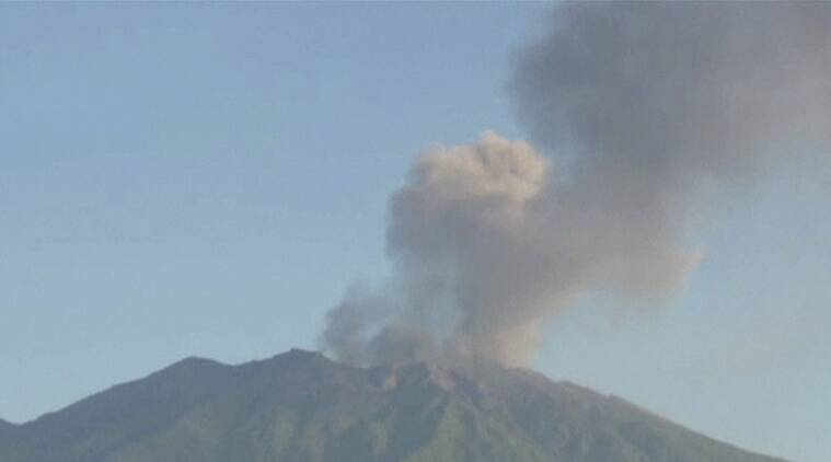 In this image made from video, Mount Raung in Banyuwangi, East Java, Indonesia, spews ash Friday, July 10, 2015. Ash spewing from a volcano on Indonesia's main island of Java has sparked chaos for holiday makers as airports close and international airlines cancel flights to tourist hotspot Bali, stranding thousands. (Photo via AP Video) TV OUT