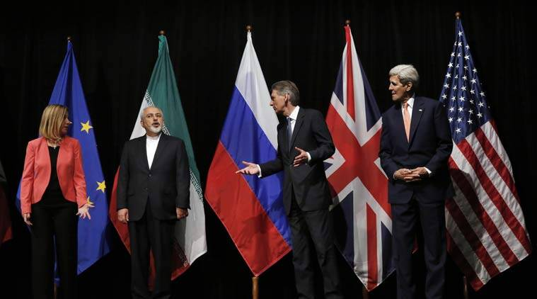 British Foreign Secretary Philip Hammond, 2nd right, U.S. Secretary of State John Kerry, right, and European Union High Representative for Foreign Affairs and Security Policy Federica Mogherini, left, talk to Iranian Foreign Minister Mohammad Javad Zarif at the Vienna International Center in Vienna, Austria. (AP photo)