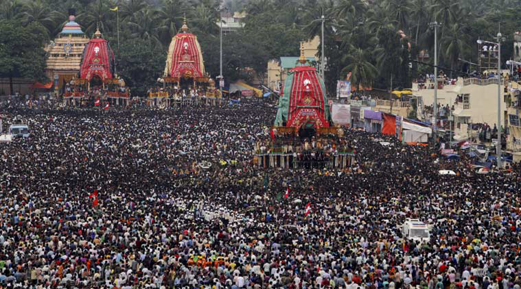 Hindu devotees throng a chariot of Lord Balabhadra during the return chariot festival at Puri, Orissa state, India, Sunday, July 26, 2015. (Source: AP Photo)