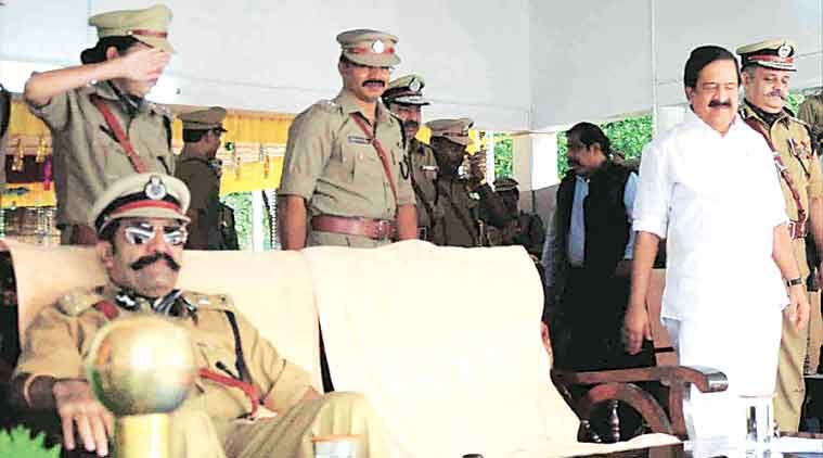 ADGP Rishi Raj Singh (left) in his seat as Home Minister Ramesh Chennithala arrives at the venue.(Source: Express Photo)