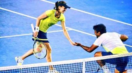 Paes-Hingis storm into mixed doubles quarters