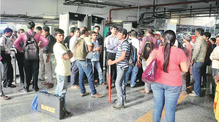 Stranded passengers wait for Metro service to resume  on Wednesday. (Source: Express Photo)