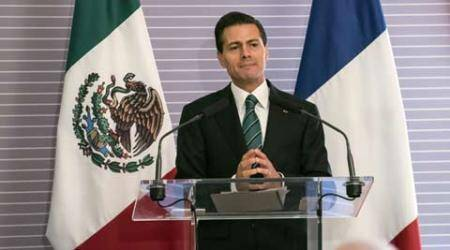 Drug lord 'El Chapo' Guzman's jailbreak clouds Mexican President's visit toFrance