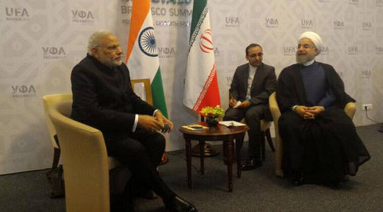 PM Modi speaking with Iranian President Hassan Rouhani in Russia (Source: Twitter/Vikas Swarup)