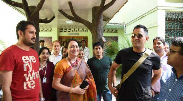 away from cricket ms dhoni visits a school in bokaro