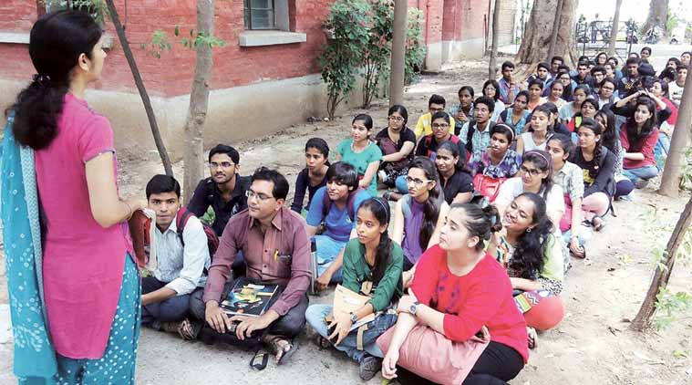 Students sit on pavement for  French classes. (Source: Express photo by Bhupendra Rana)
