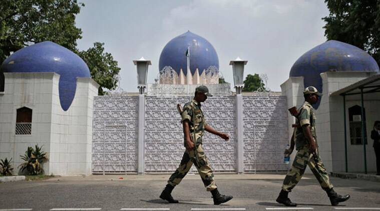 FILE: Indian security personnel walk past the main gate of Pakistan High Commission in New Delhi (Source: Reuters)