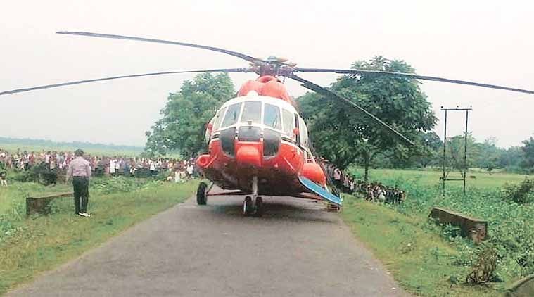 A Pawan Hans helicopter lands at a village in Sonitpur district of Assam on Tuesday. (Source: PTI)