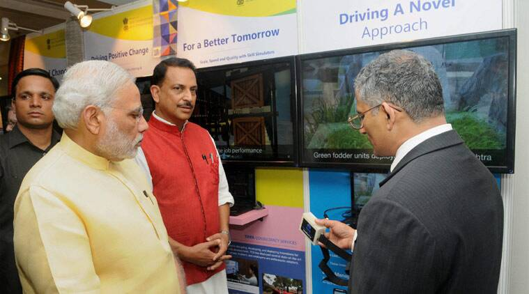 Prime Minister Narendra Modi visiting an exhibition at the launch of the National Skill Development Mission, in New Delhi on Wednesday. Minister of State for Skill Development & Entrepreneurship (Independent Charge) Rajiv Pratap Rudy is also seen. (Source: PTI)