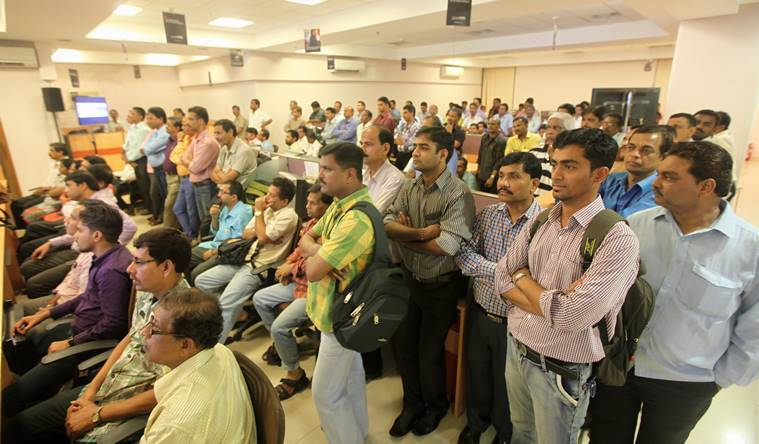 Express staffers listen to the CMD's address at the Mahape office in Navi Mumbai on Friday. (Source: Express photo by Prashant Nadkar)
