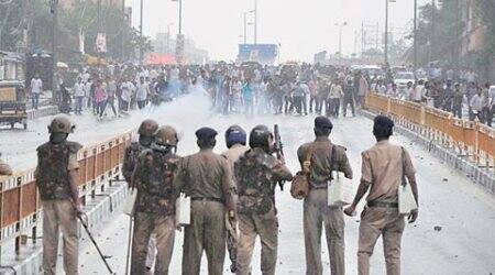 Police fire tear gas shells at protesting Congress workers in Bhopal on Thursday. (Source: PTI photo)