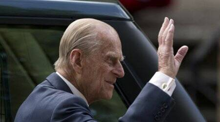 VIDEO: Britain's Prince Philip caught on camera swearing at photographer