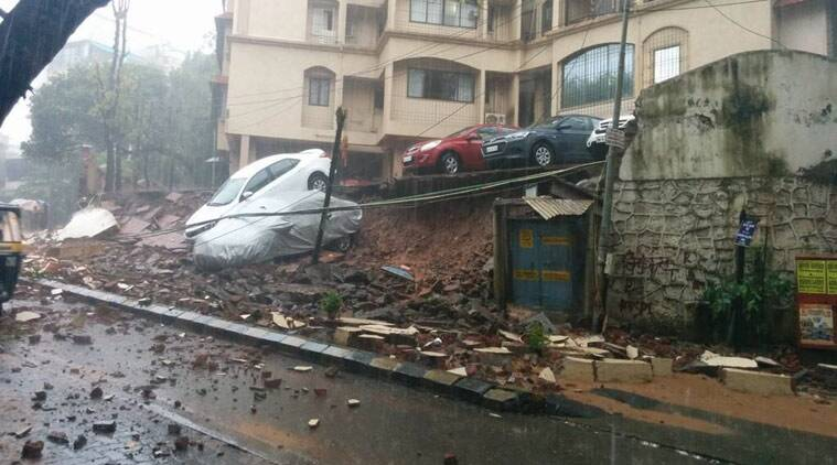 Rain destroys an elevated parking lot/wall on Mumbai's Carter Road.  cars rolling onto road. Bandra