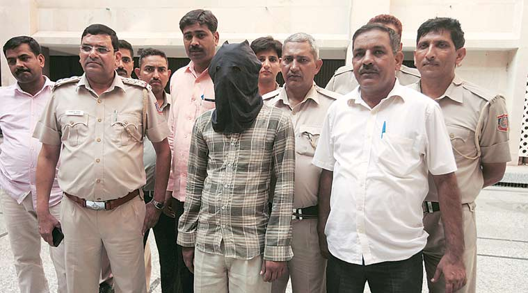The accused Ravinder at Begumpur police station on Sunday. (Source: Express photo by Amit Mehra)