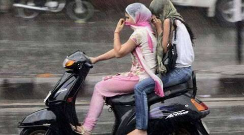Police check ids of women riding bikes with covered faces in the wake of Gurdaspur attack