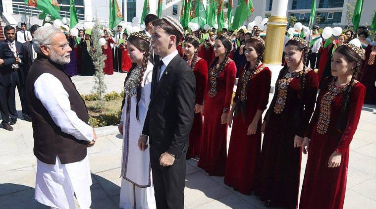 Turkmenistan students speaks in hindi about Mahatma Gandhi to Prime Minister Narendra Modi during the unveiling of a bust of Gandhi at Ashgabat in Turkmenistan on Saturday. PTI Photo by Manvender Vashist