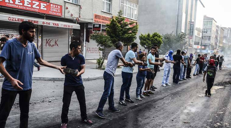 Protesters carry stones to build a barricade in Istanbul, Friday, July 24, 2015, prior to clashes between police and protesters denouncing the deaths of 32 people at an suicide bombing Monday in Suruc, southeastern Turkey. Turkish warplanes struck Islamic State group targets across the border in Syria early Friday, in a strong tactical shift for Turkey which had long been reluctant to join the U.S.-led coalition against the extremist group. (AP Photo/Cagdas Erdogan, Depo Photos) TURKEY OUT