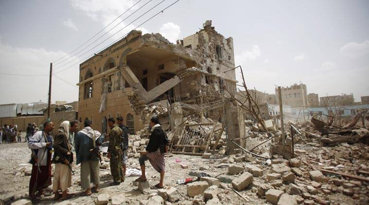 Shiite rebels known as Houthis, gather at houses destroyed by a Saudi-led airstrike in Sanaa, Yemen, Friday, July 3, 2015. Yemeni security officials say the Saudi-led coalition has targeted encampments of Shiite rebels and their allies in the country's capital, Sanaa, and that several people were killed in the airstrikes. (AP Photo/Hani Mohammed)