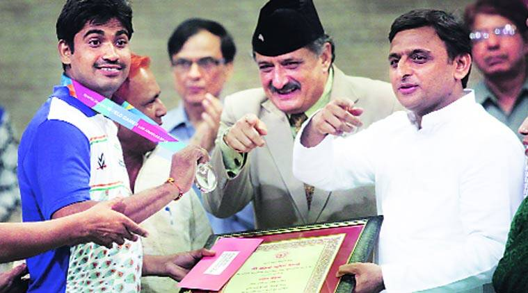 Chief Minister Akhilesh Yadav felicitates a medal-winner of 'Special Olympics World Games: Los Angeles, 2015, during a function at his official residence, in Lucknow on Saturday. Vishal Srivastav