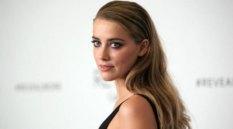 Amber Heard to fight dog smuggling charges in Australia | The Indian ...