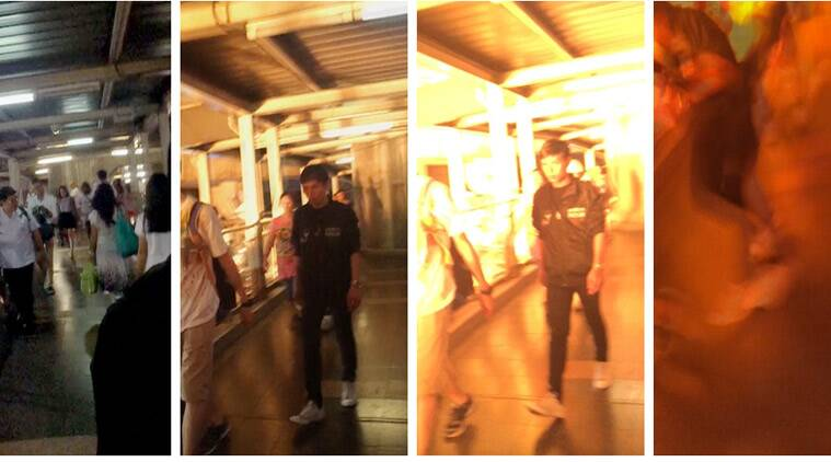 This combination of images taken from video on Monday, Aug. 17, 2015, and provided by MGTV shows people walking on an elevated skywalk as an explosion occurred in Bangkok, Thailand. Thailand's prime minister has promised to track down those responsible for the central Bangkok bombing which he described as the country's worst attack in history. (Source: MGTV via AP)