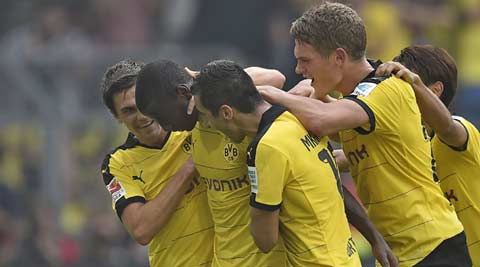 Borussia Dortmund beat Hertha Berlin 3-1 to stay atop Bundesliga
