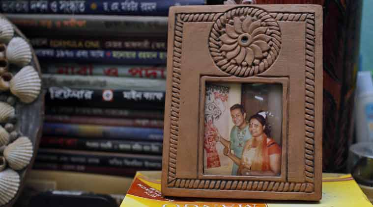 A photo frame displaying portraits of blogger Niloy Chowdhury, 40, with his wife is placed inside their room in Dhaka. (Source: AP)