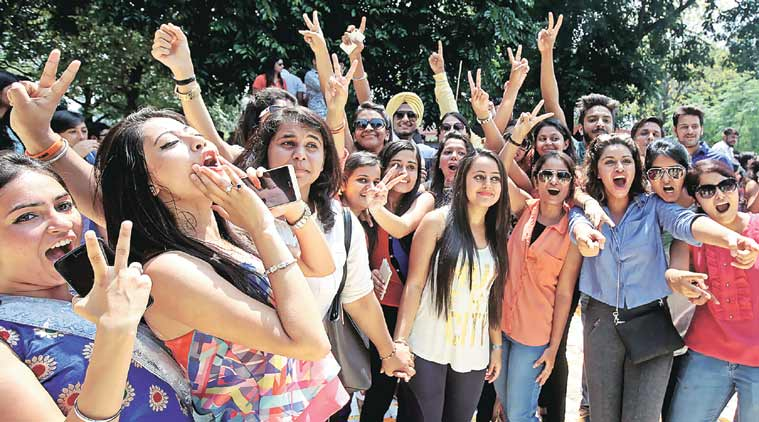 Students celebrate after election results were declared at GGDSD College, Sector 32, Chandigarh, on Wednesday. (Source: Express photo by Sumit Malhotra)